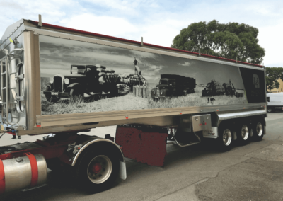 A semi's trailer shows how effective a large format sign can be on the tippers trailer