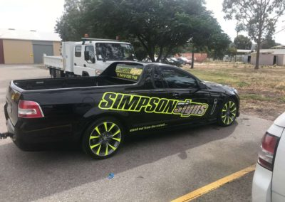 The workshop Simpson Signs ute with a body wrap promoting Simpson Signs