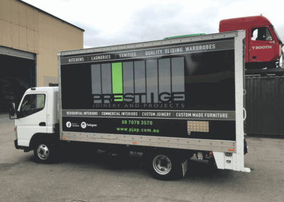 A delivery tuck that has a vehicle wrap style large format sign which is a reproduction of the company's website