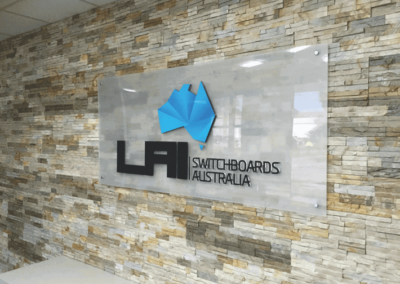 Indoor wall mounted glass sign with 3 D lettering