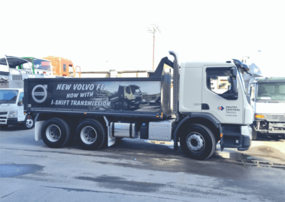 A semi trailer tipper features large format printed sign for advertising on the tippers side
