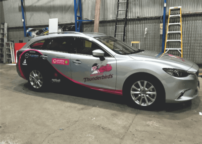 A car body wrap that was designed as a promotional sign for a sporting team