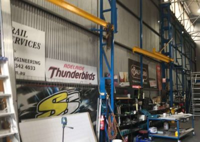 The workshop is very tall with ladders, scaffolding and mobile desks and trolleys to make the fixing of signs and sign writing on trucks and buses more accessible