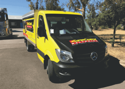 A Mercedes van that has been body wrapped in strikingly contrasting Colours