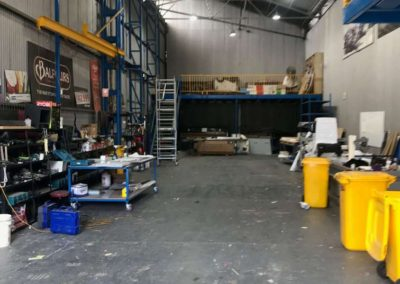 The sign writing work shop area is very long because it has to accomodate semi trailers and depending on the amount of time applying the signage might take, the trailer and the semi cabin might need to be locked into the workshop overnight