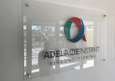 Indoor wall mounted glass sign with 3 D painted glass lettering