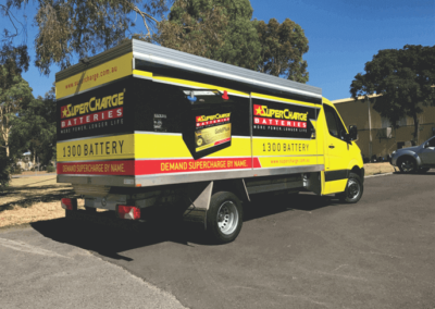 A specialist delivery van features signage on all sides