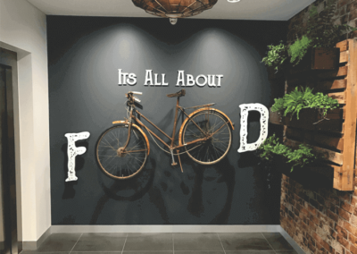 Very innovative foyer area sign incorporating a bicycle and 3 D lettering