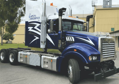 A striking sign-writing job on this large semi-trailers cabin shows the company name, sign written, plus large vinyl cut transfers, featuring lightning strikes