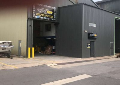 The entrances to Simpson Signs Showing two large entrance roller shutters allowing access for the biggest trucks
