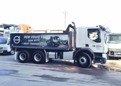A Tandem trailer tipper, with a large format digital sign applied to the back of the truck and the companies name and logo applied via a vinyl sign to the cabin